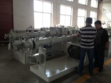 Rubber extruding machine, hot continuous vulcanizing machine
